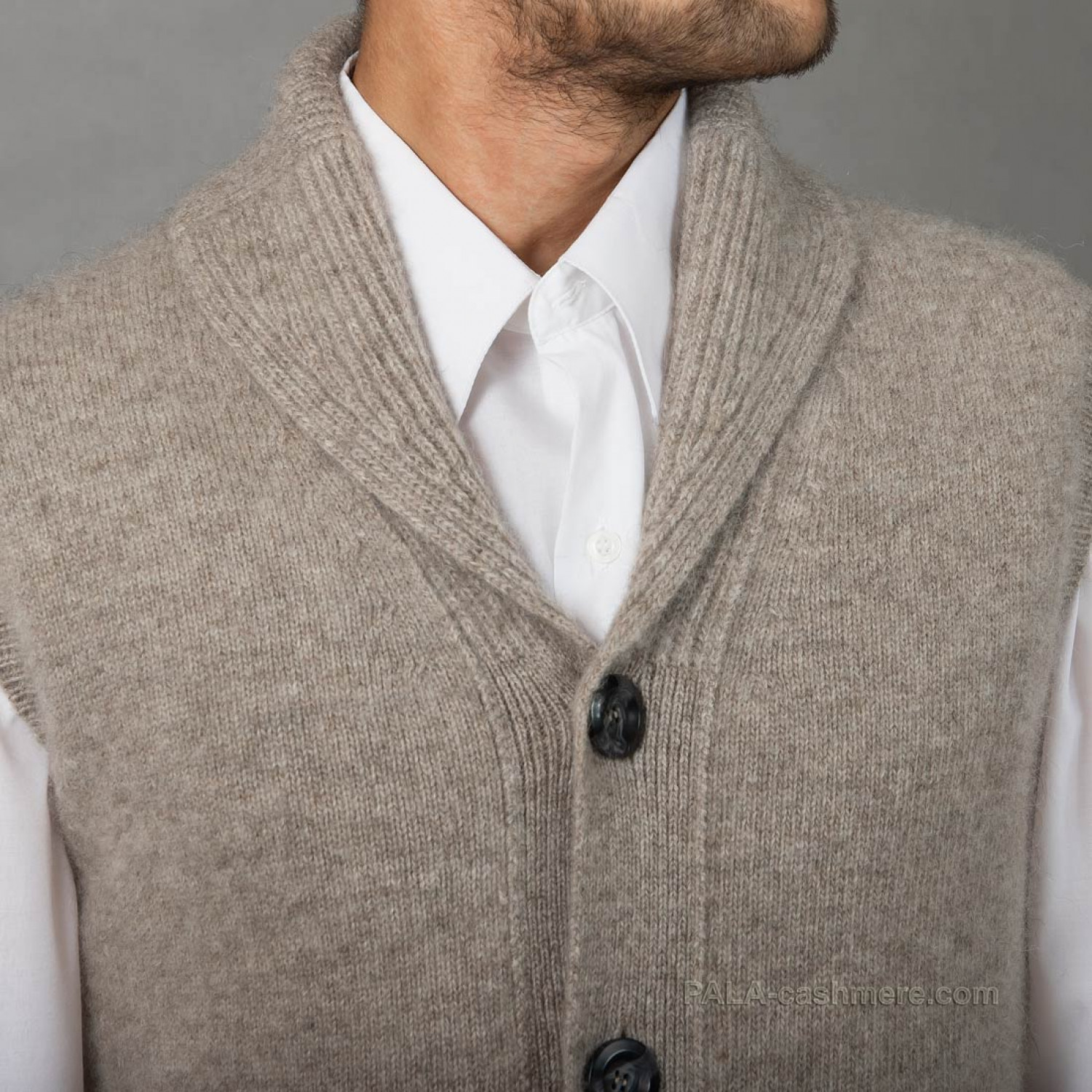 A man's vest with a collar and buttons