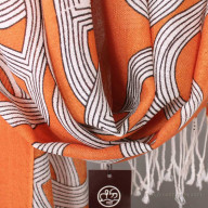 Tippet from wool with a pattern orange 65x180