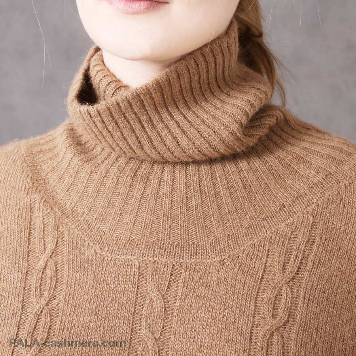 "Sweater-tunic of camel wool with a pattern of ""pigtail"""